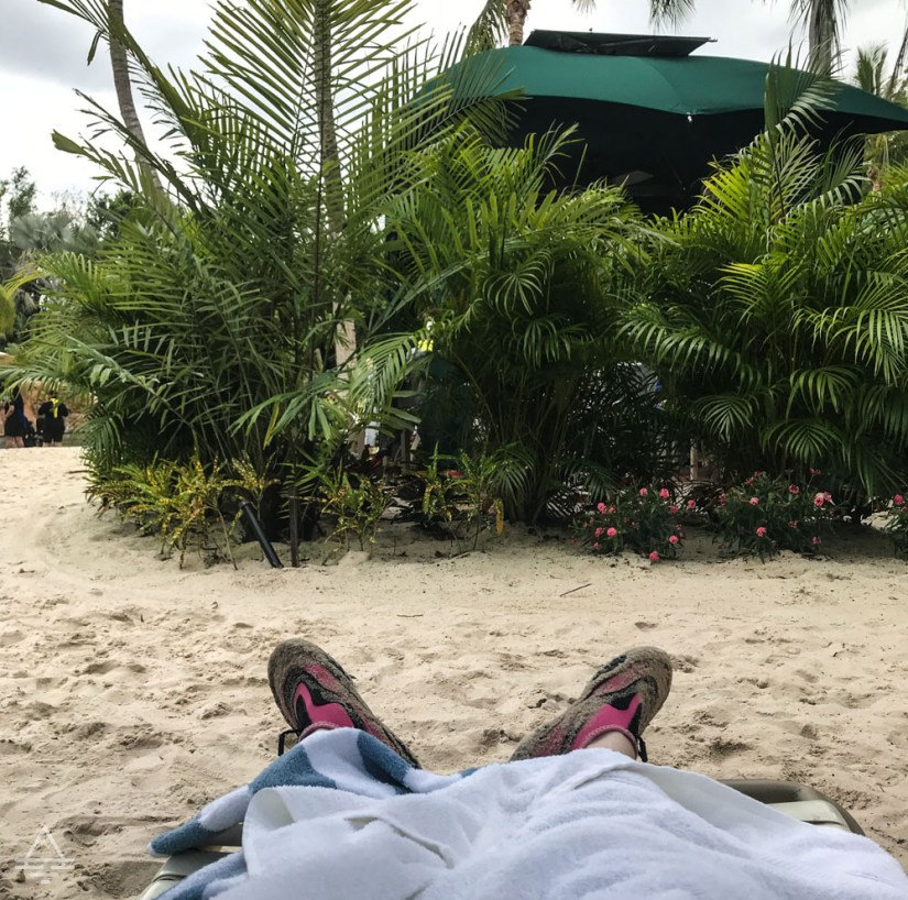 Feet in a beach chair at Discovery Cove