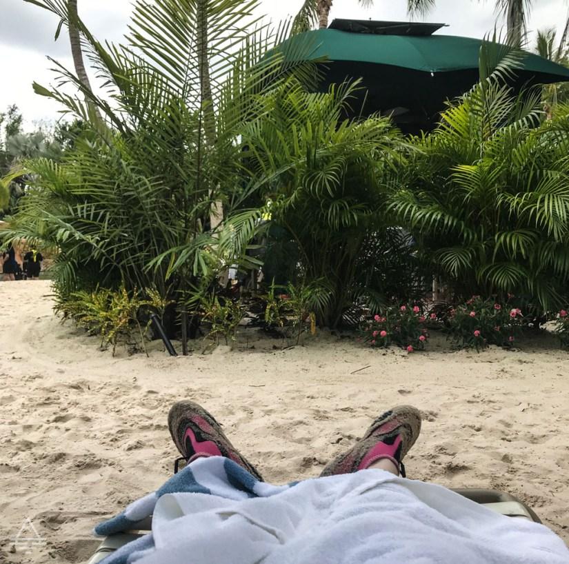 Feet in a beach chair at Discovery Cove