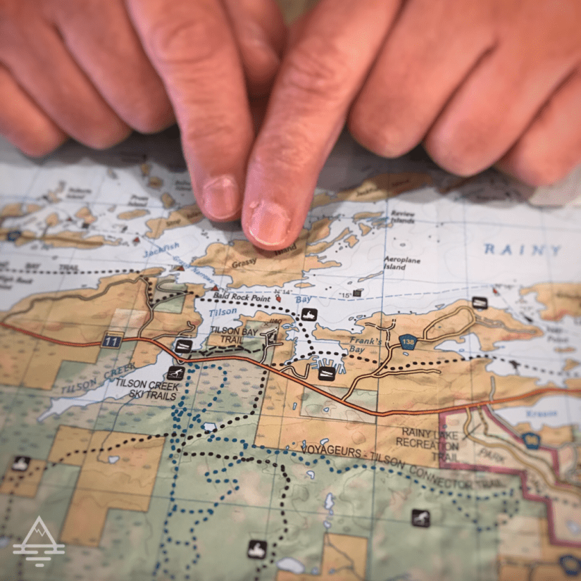 Finger Pointing to Voyageurs National Park Map