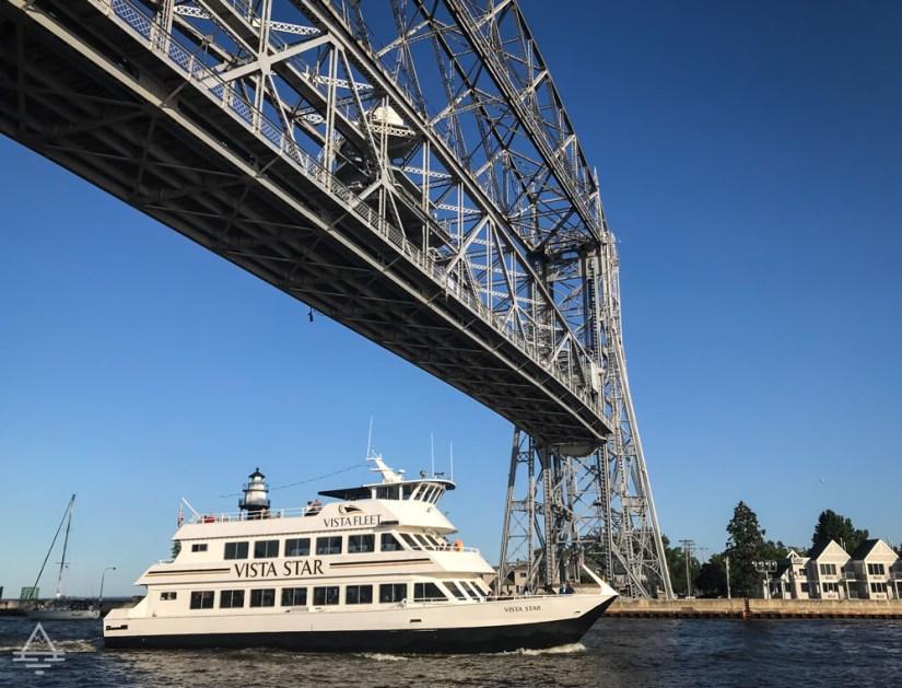 Boat Going Under Aerial Lift Bridge