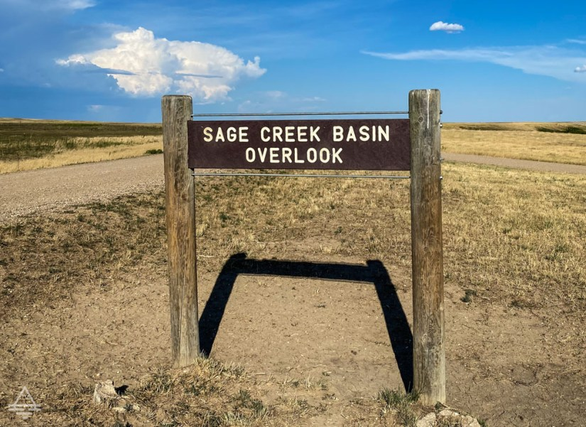 Sign reading Sage Creek Basin Overlook on Badlands Sage Creek Rim Road