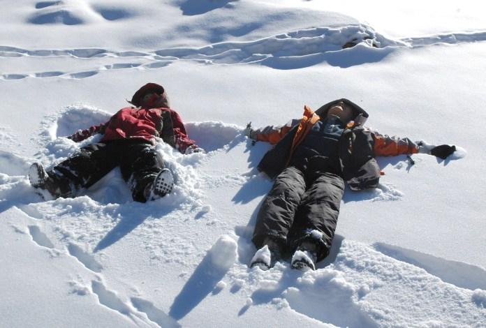 boys making snow angels