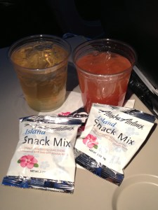 Alaska's mai tai, passion orange guava juice, and aloha snack mix!