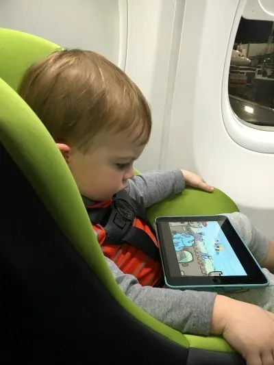 International Travel With Car Seats - Toddler on Plane in Car Seat