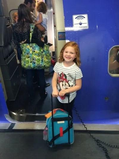 Holiday Air Travel - Girl Boarding Plane