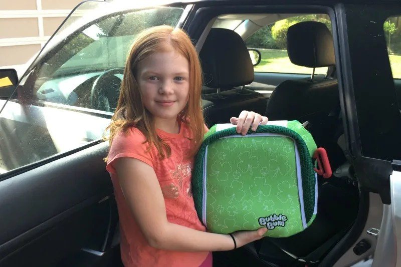 BubbleBum Review - Child Installing Booster in Car