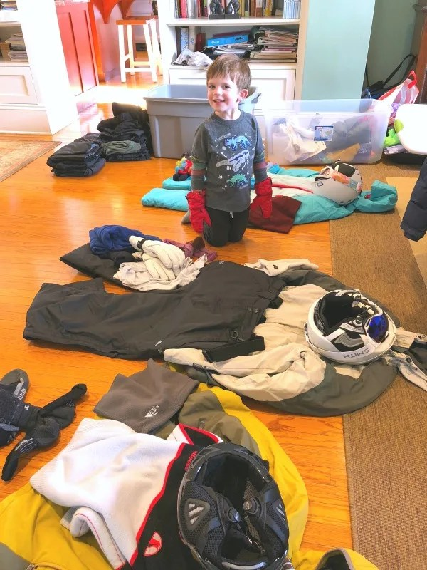 Child First Time in Ski School - Packing and Trying on Gear