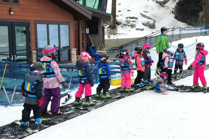 First time ski school kids line up for the magic carpet at Diamond Peak in Lake Tahoe.