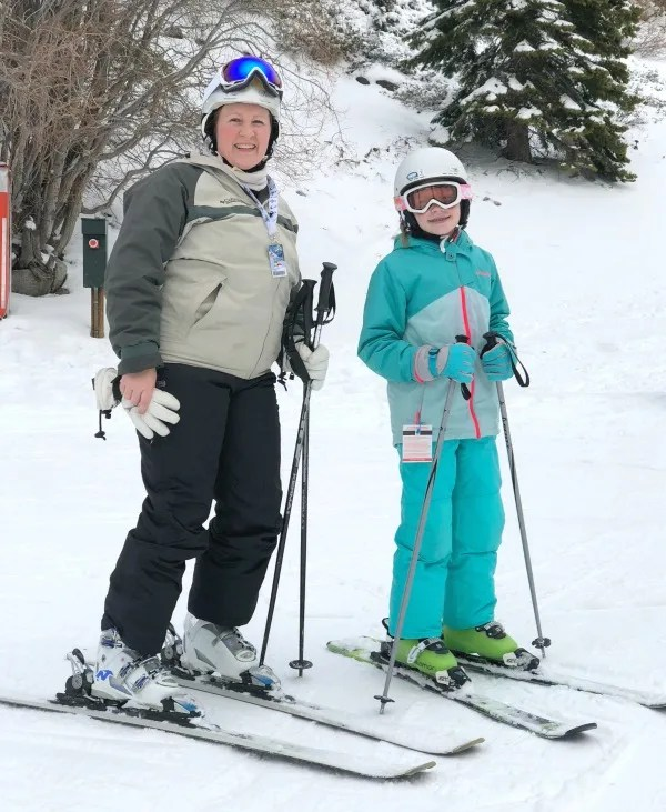 Mother and daughter skiing together at Diamond Peak while younger brother is in his first ski school.