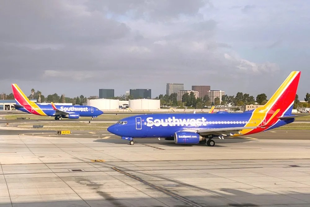 Airlines waiving change fees for coronavirus - Southwest planes taxi