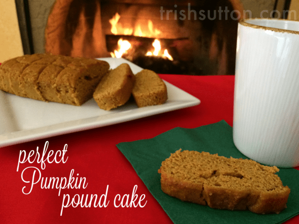 pumpkin loaf with a mug and fireplace in the background