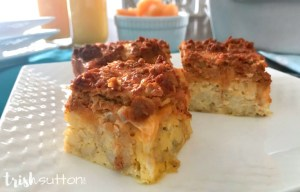 Chorizo Egg Casserole on a white plate; overnight breakfast recipe