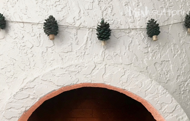 Create festive winter decor with just pinecones, craft paint & jute. Simple DIY Winter Decor; Pinecone Christmas Garland. TrishSutton.com