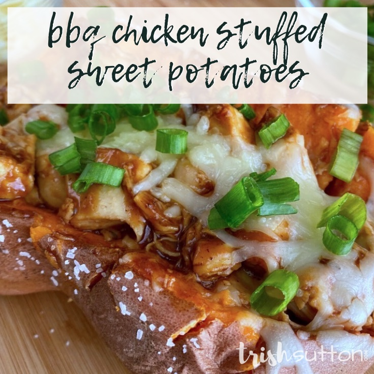 Sweet Potato filled with barbecue sauce covered chicken topped with cheese & green onions.
