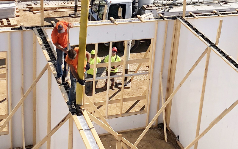 Concrete being poured into wall forms built by Tri State Car Wash Solutions