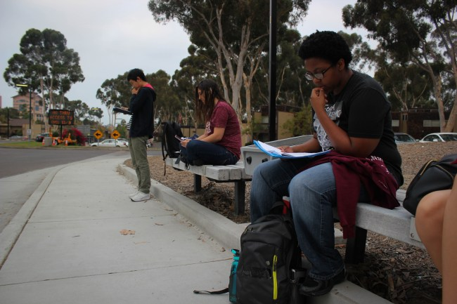 Students wait for the bus near the Mesa Appartments. Connor Gorry / The Triton.