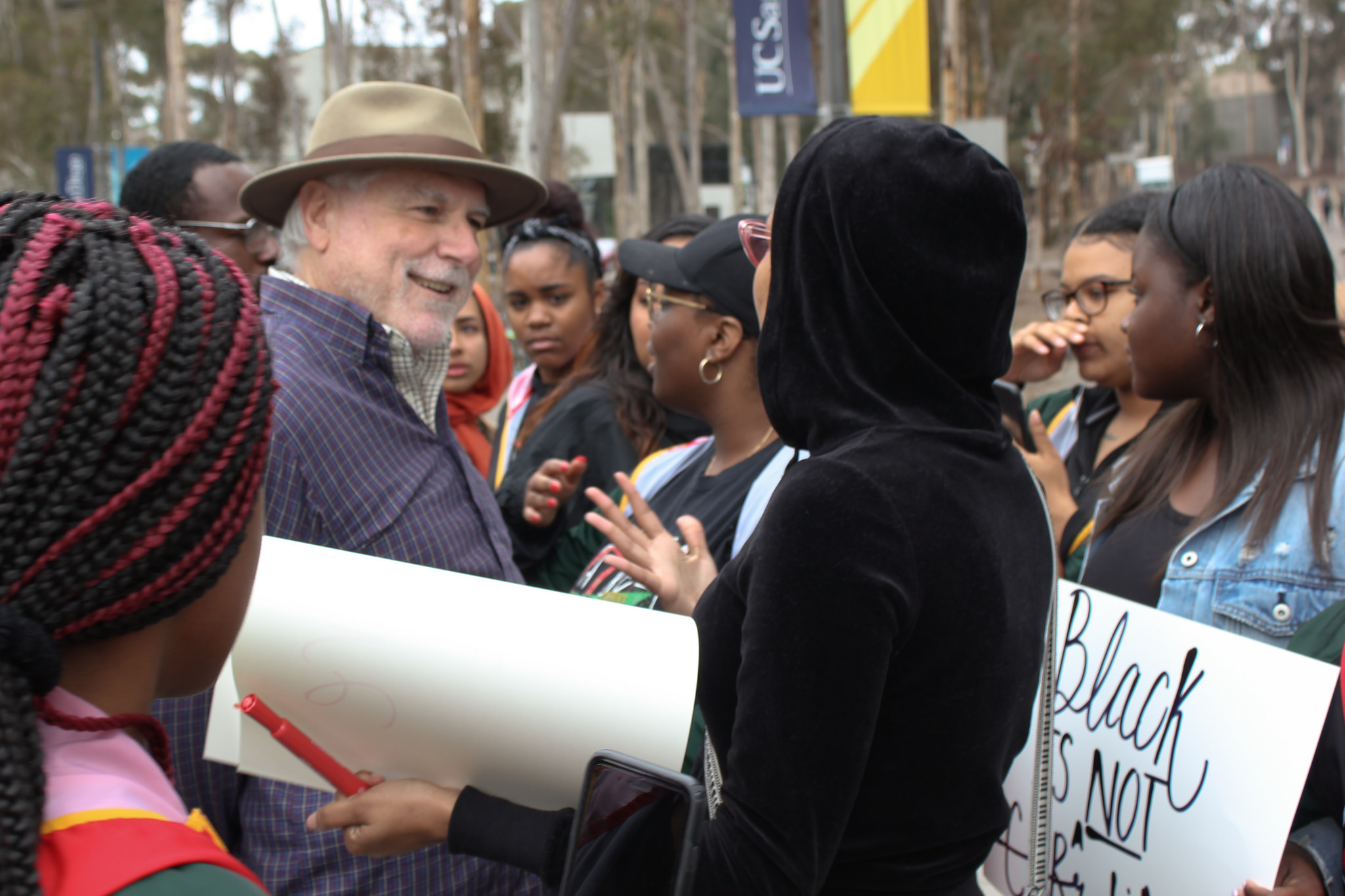 Physics Professor Emeritus Fred Driscoll repeatedly asked protesters about OASIS and refused to step back after he was asked.