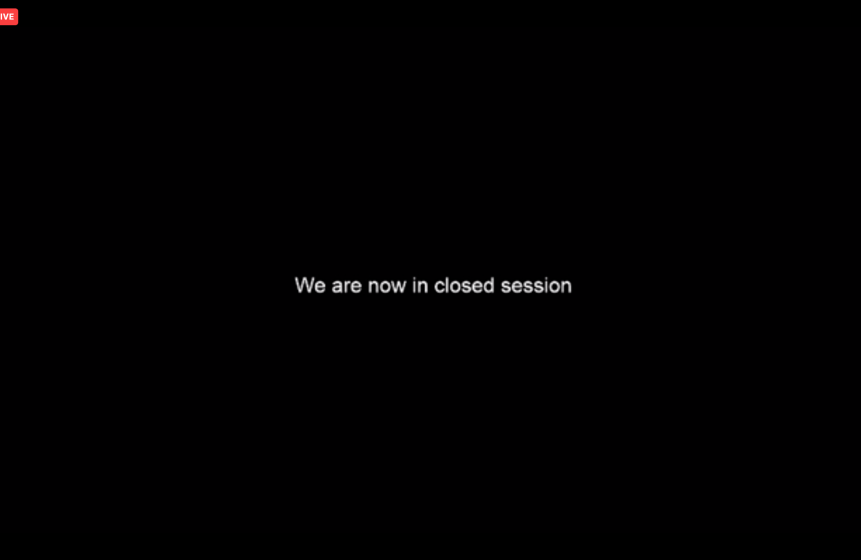 "black background with text saying ""we are now in closed session"""