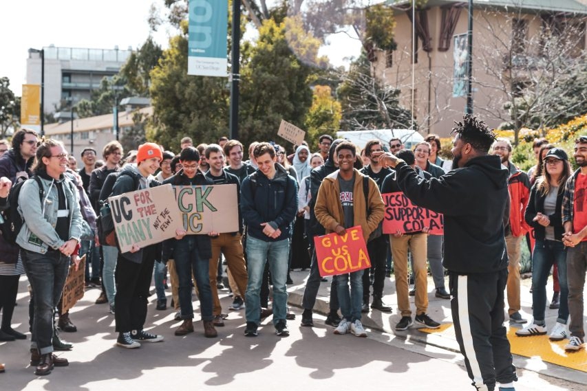 Photo of UC San Diego Graduate Students demonstrating in support of a systemwide Cost of Living Adjustment.
