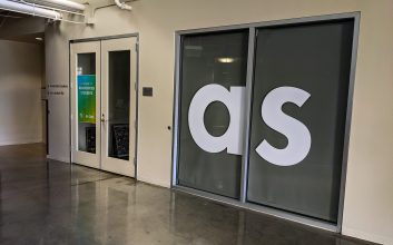 Photo of the Associated Students of UC San Diego offices with closed doors on the 4th floor of Price Center