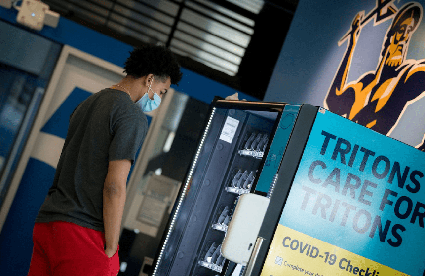 Photo of student using a vending machine.