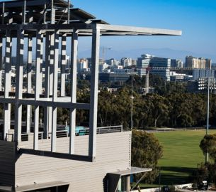 UCSD building in the foreground, skyline in the backgroud, UCSD campus