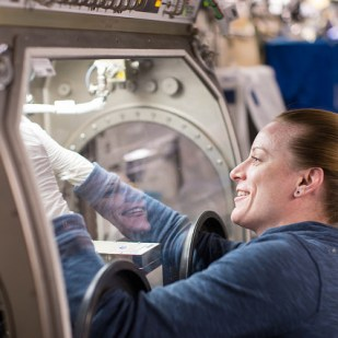 Rubins works inside the Microgravity Science Glovebox, one of the dedicated science facilities aboard the ISS that provides a sealed environment for conducting science and technology experiments.