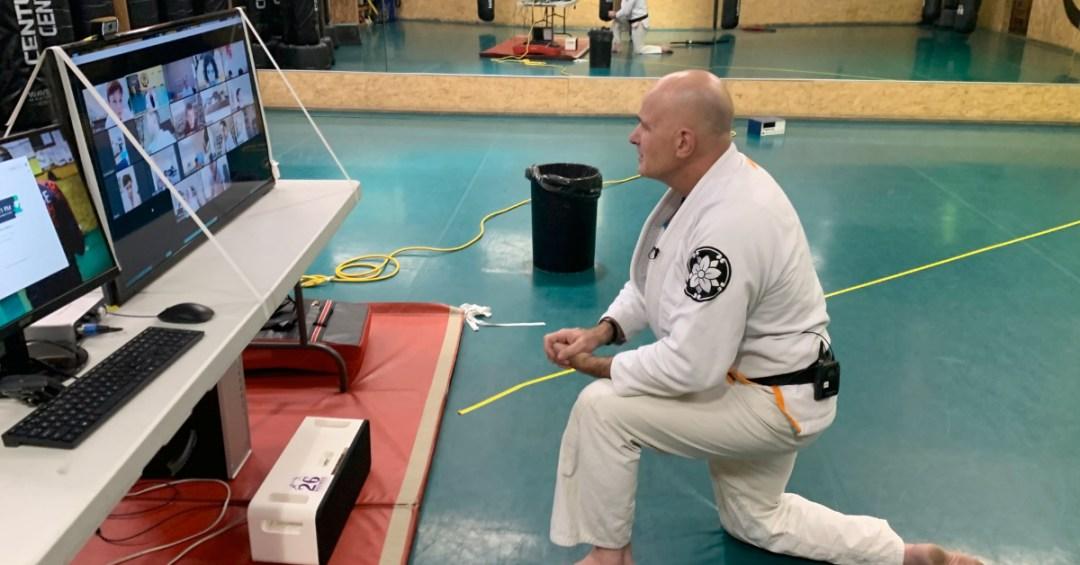 man teaching online martial arts