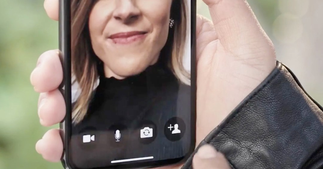 person holding mobile phone with image of woman