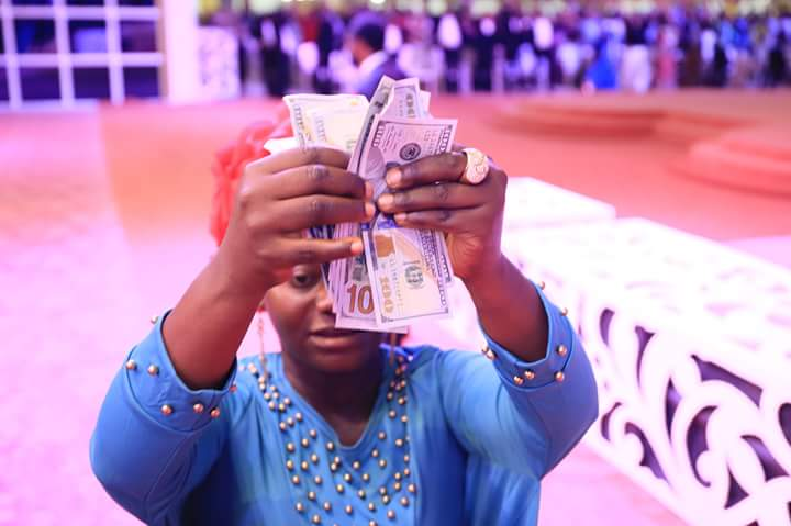 Bro.Joshua Iginla Of Champions Royal Assembly, Supports Female Cobbler With 1,000 U.S Dollars For Her Growing Business