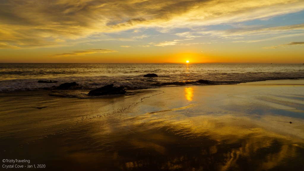 beautiful sunset colors with waves on the beach