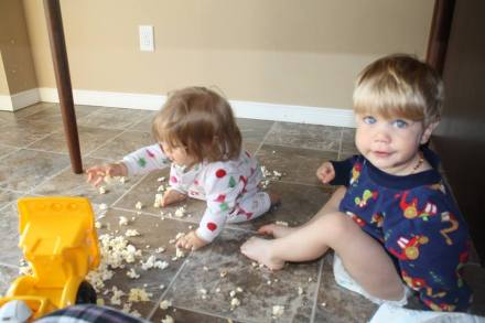 Embrace the popcorn eating under the table with the dump truck.