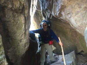 Mr. Dionne navigates a bolder archway on the way to Mount Rogers