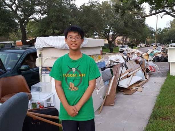 Boy standing next to garbage