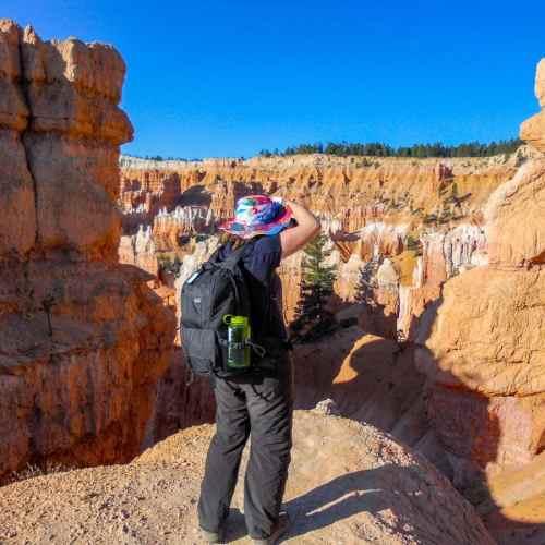 Woman photographing Bryce Canyon, USA