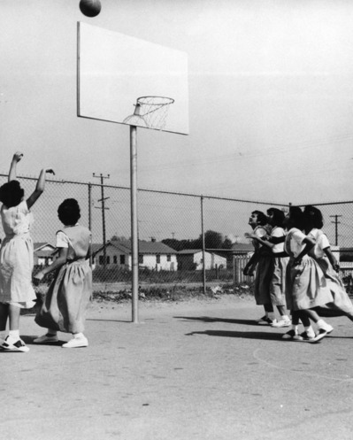 Girls' basketball game at Holy Family School at Holy Family Catholic Church in Wilmington, circa 1952 | Shades of L.A. Collection, Los Angeles Public Library