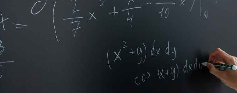 mathematical equation written on blackboard