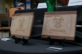 The teams were competing for cutting board awards. One board was given to the winning team, one to the runner-ups, and one to the fan favorites as voted on through Facebook.