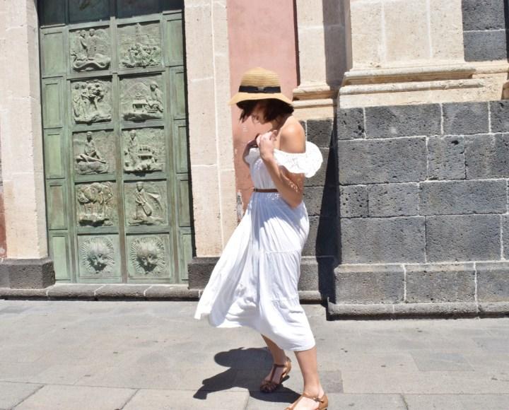 The long white skirt as a white ruffle dress.