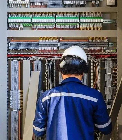 An Electrician Repairs an Electrical Panel