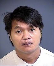 Pao S. Hang was arrested for spraying feces on products at Harris Teeter supermarket
