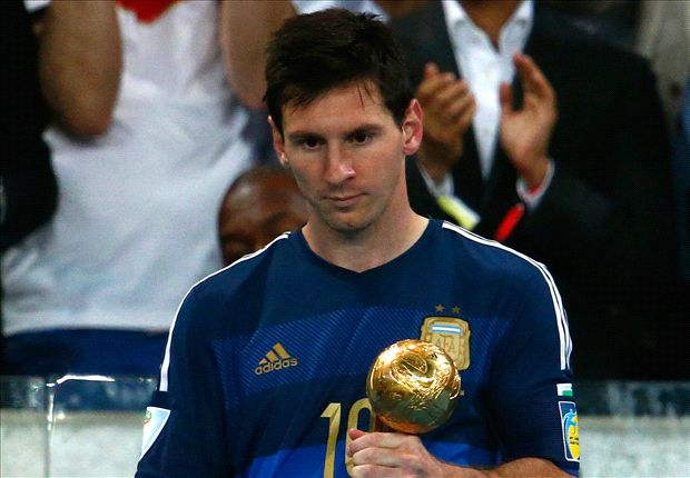 A dejected Lionel Messi with the Golden Ball award after 2014 FIFA World Cup final.