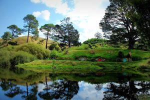 Hobbit holes reflected in water