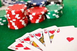 5 card hand of poker (Royal Flush, hearts), with poker chips