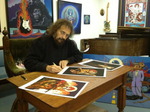Stanley Mouse signing the fine art prints.