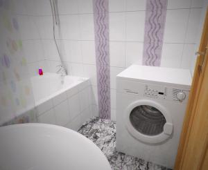 Фото: стиральная машина подключена в ванной
