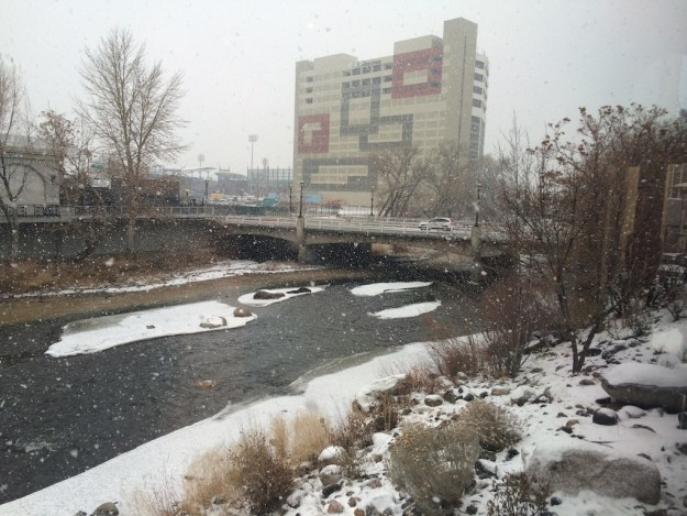 Winter snow with a barely flowing Truckee River through downtown Reno at Lake Street Bridge during the TROA Celebration.