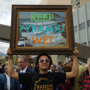 """""""Keep Pyramid Wet"""" painted on a canvas carried at Virginia Street Bridge over the Truckee River dedication"""