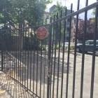 Fenced in walkway along river near Broadhead Park