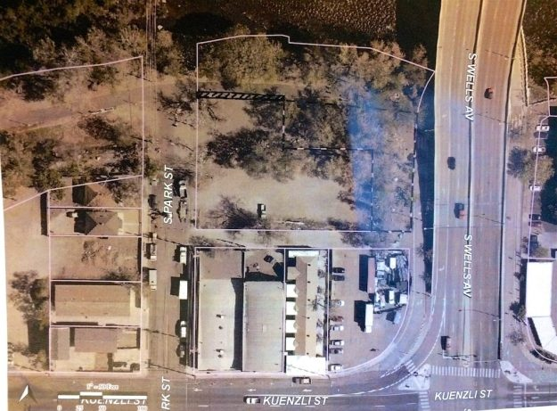 Overhead view of property (right-most parcel outlined in black-white) to be transferred to developers for a new apartment complex.
